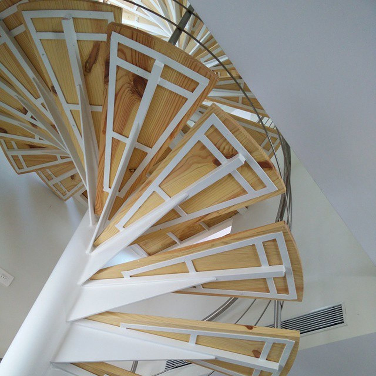 staircase, steps and staircases, steps, no people, indoors, architecture, railing, spiral, built structure, spiral stairs, low angle view, close-up, spiral staircase, day