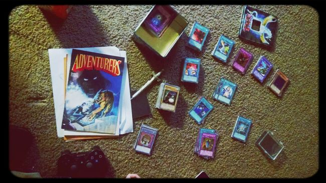 My daughter is enjoying her gifts from Saint Nicholas Day . now she's organizing her Yu Gi Oh Cards & Comics
