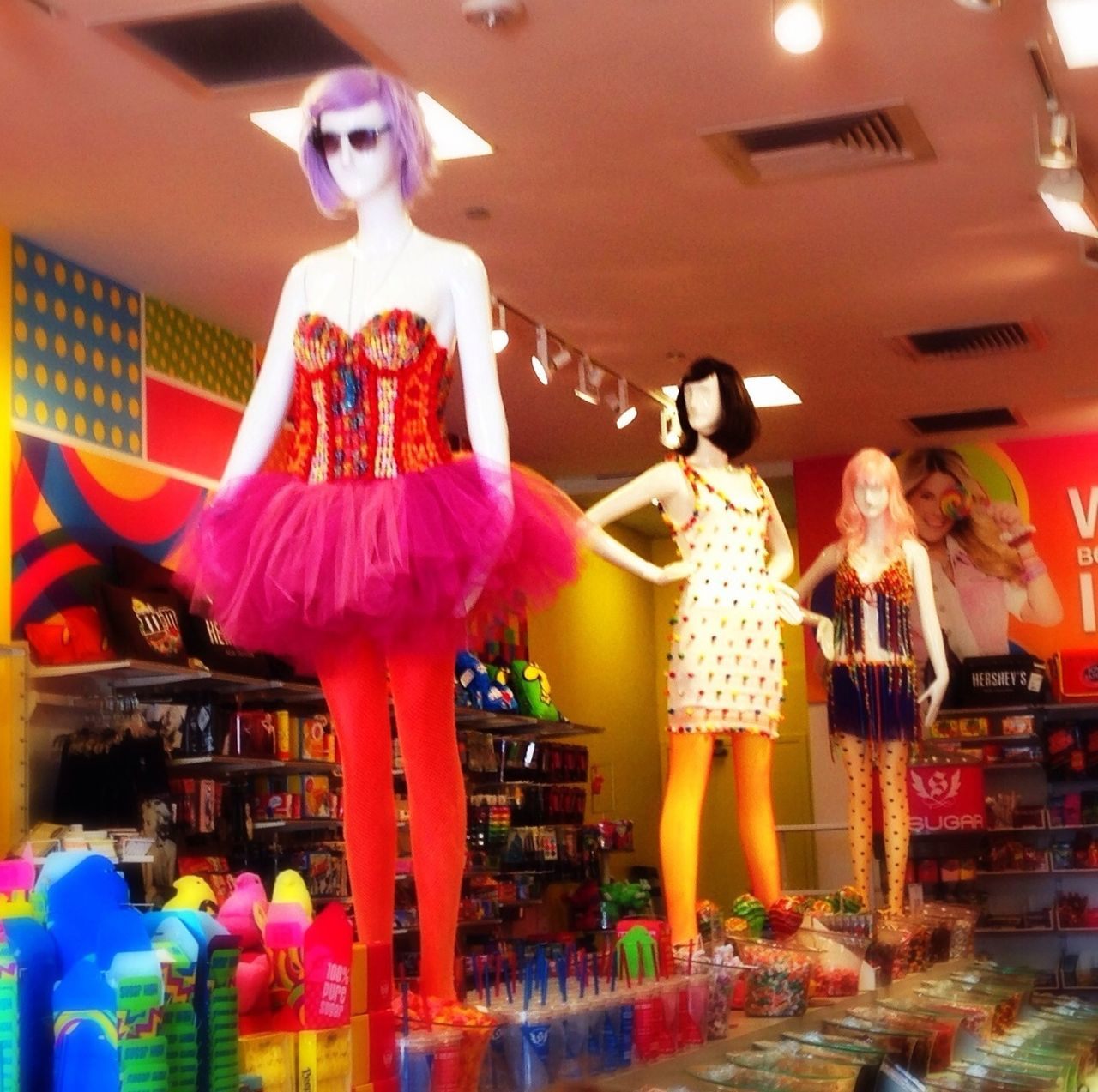 human representation, indoors, real people, low angle view, statue, retail, sculpture, multi colored, day
