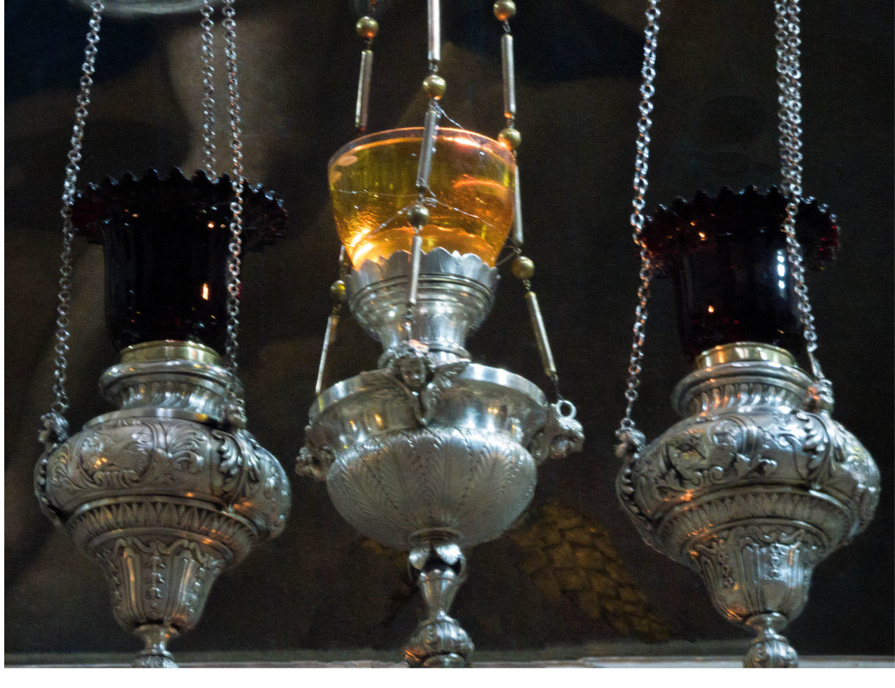 Armenian and Greek Orthodox silver oil lamps light the rotunda of the Church of the Holy Sepulchre in Jerusalem, Israel. Church Of The Holy Sepulchre Hanging Lamps Israel Jerusalem Light No People Oil Lamps Silver  Silver And Glass Oil Lam Transparency