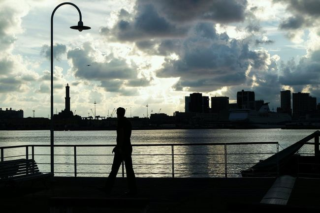 Cloud - Sky Silhouette Sky City Weather Water Storm Cloud Full Length Outdoors Horizontal Travel Destinations Urban Skyline Sunset Architecture Cityscape One Person People Adult Nature Person EyeEm Best Shots Eye4photography  Fresh 3 Open Edit Streetphotography