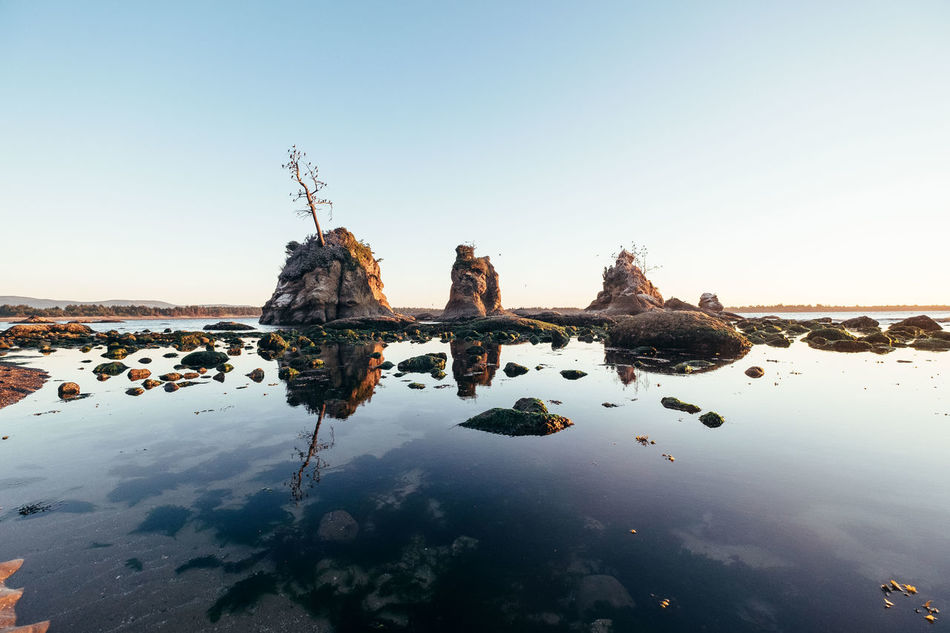 Three Graces Reflection Water Silhouette No People Nature Outdoors Sky Beauty In Nature Oregon Coast Sea Beach Sunrise Seascape Travel Tourism Adventure Landscape Tranquil Scene Tranquility Low Tide PNW Garibaldi Art Is Everywhere TCPM
