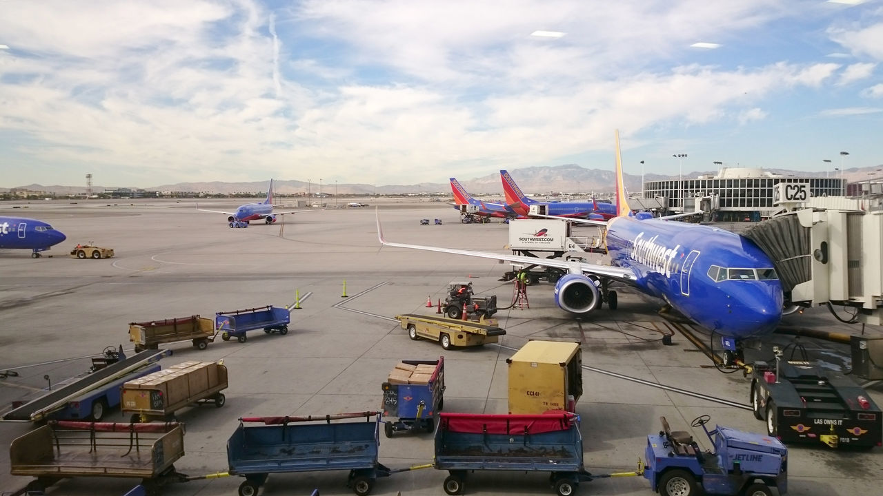 Southwest Airline airplane Boeing 737 being loaded by baggage handler at the tarmac of McCarran International Airport in Las Vegas, Nevada, United States taken on Sep, 26, 2015. Airport Airports At The Airport Boeing 737 Boeing 737-700 Development High Angle View Mode Of Transport Southwest Airline Southwest Airlines Transportation Travel