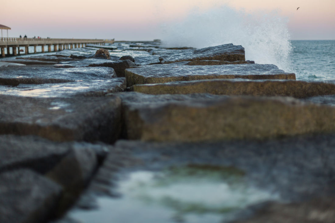 Breakwater at twilight Beach Breakwater Closeup Crashing Waves  Focus On Foreground Glow Glow In The Sky Nature No People Ocean Ocean View Orange Glow In The Sky Outdoors Reflection Rock Texture Rocks Shallow Depth Of Field Sky Splashes Texture Twilight Water Waterfront Waves