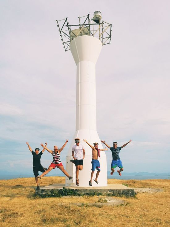 The high five. Togetherness Outdoors Friendship Smiling Jump Shot Happiness Lighthouse Caramoan Island, Camarines Sur Philippines Live For The Story