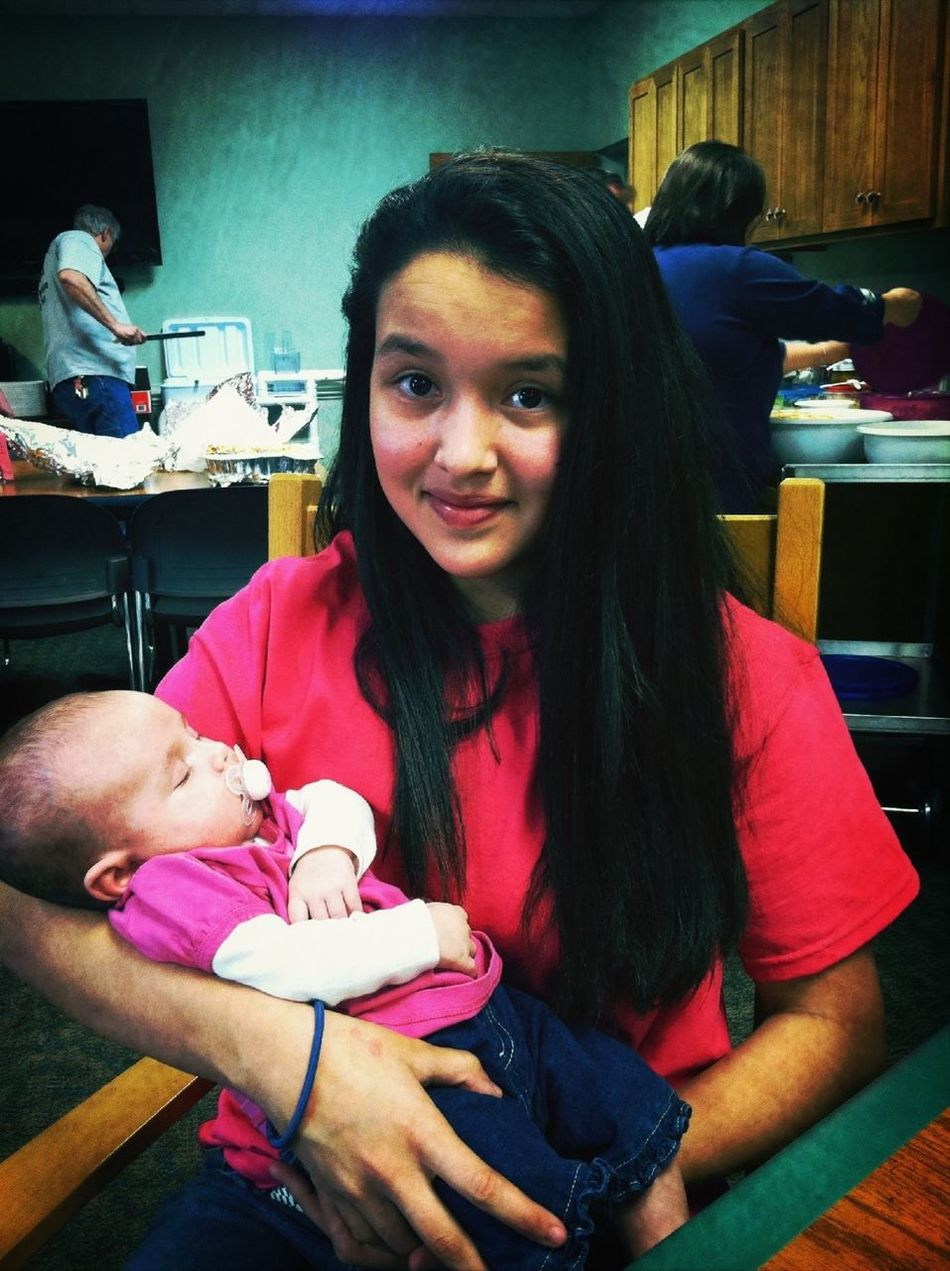 Holding my new baby cuz se is so cute and small!