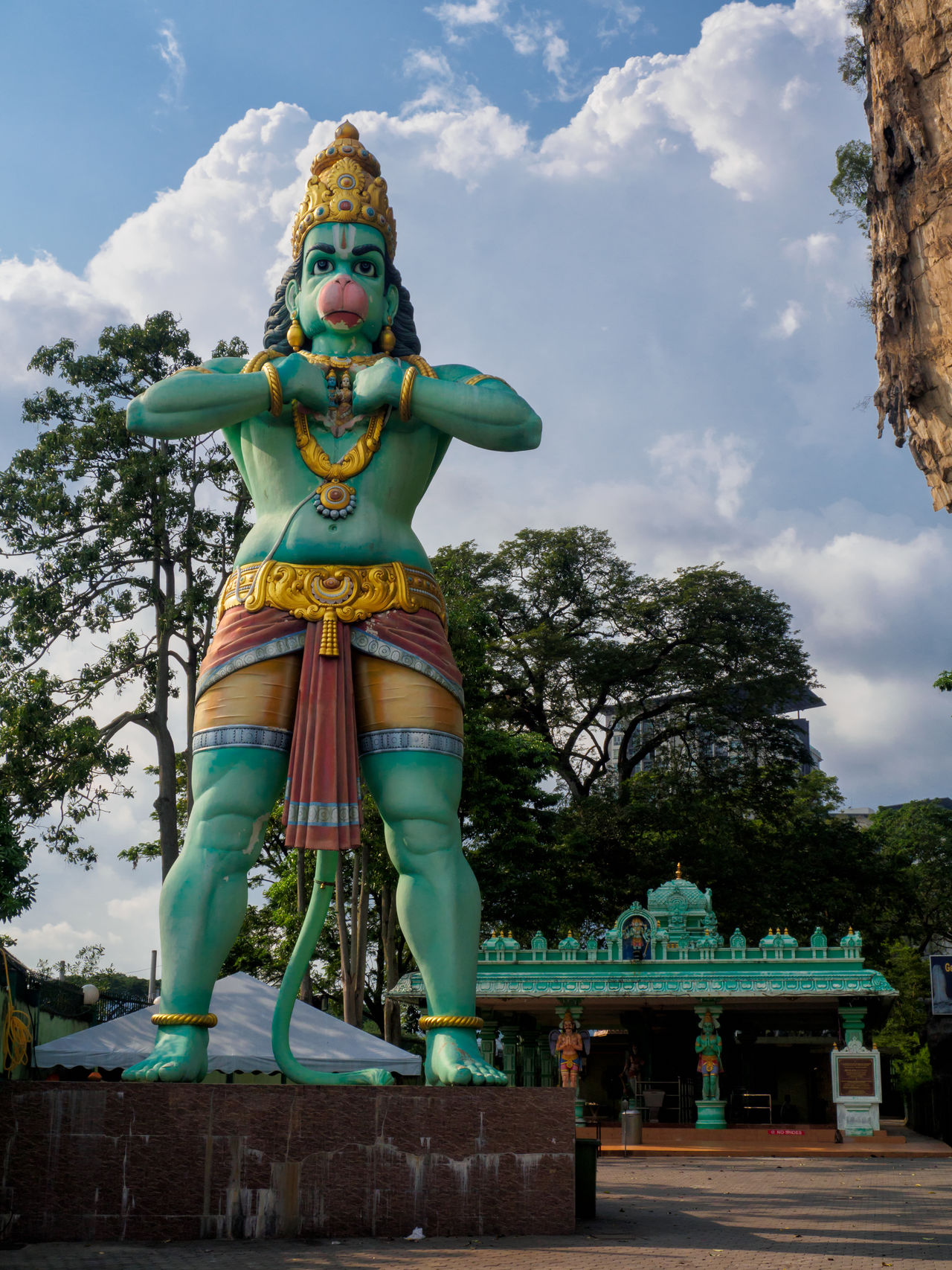 Lord Hanuman deity statue at Batu Caves in Kuala Lumpur, Malaysia Architecture Batu Caves Cultures Day Deity God Hanuman Hinduism Kuala Lumpur Low Angle View Malaysia Monkey No People Outdoors Religion Sculpture Sky Statue