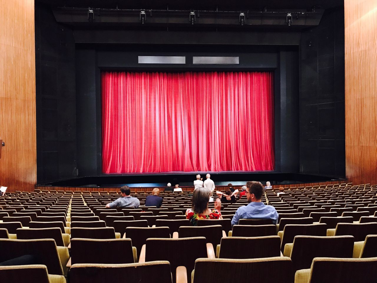 Curtain Preparation  Chair Stage - Performance Space Indoors  Performance Real People Arts Culture And Entertainment Performing Arts Event Red Seat Men Audience Sitting Togetherness Auditorium Day Teamwork Film Industry People