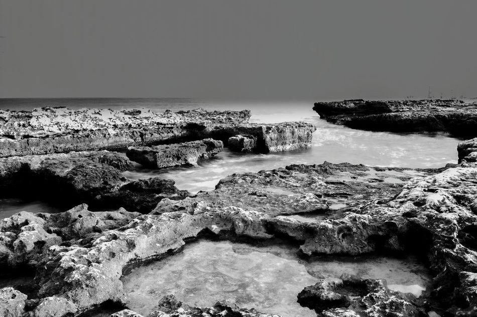 Sea Horizon Over Water Monochrome Black & White Nature Dark Scenery Dark Place Slow Shutter Long Exposure Capture Blackandwhite Horizon Over Sea Waves And Rocks Rocks And Water Rocks In Water Waves, Ocean, Nature Blackandwhite Photography Los Baños De La Reina El Campello Monochrome Photography Landscape Beauty In Nature Horizon Outdoors Water Scenics Slowshutter