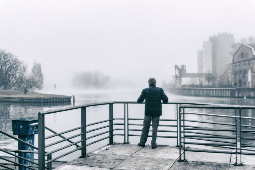 Man standing at railing of the junction of Havel and Spree River in Spandau in Berlin, Germany Architecture Berlin Color Image Confluence Foggy Day Germany🇩🇪 Havel River Horizontal Junction Man Nature No People Outdoors Photography Railing Selfie Spree River Berlin Standing