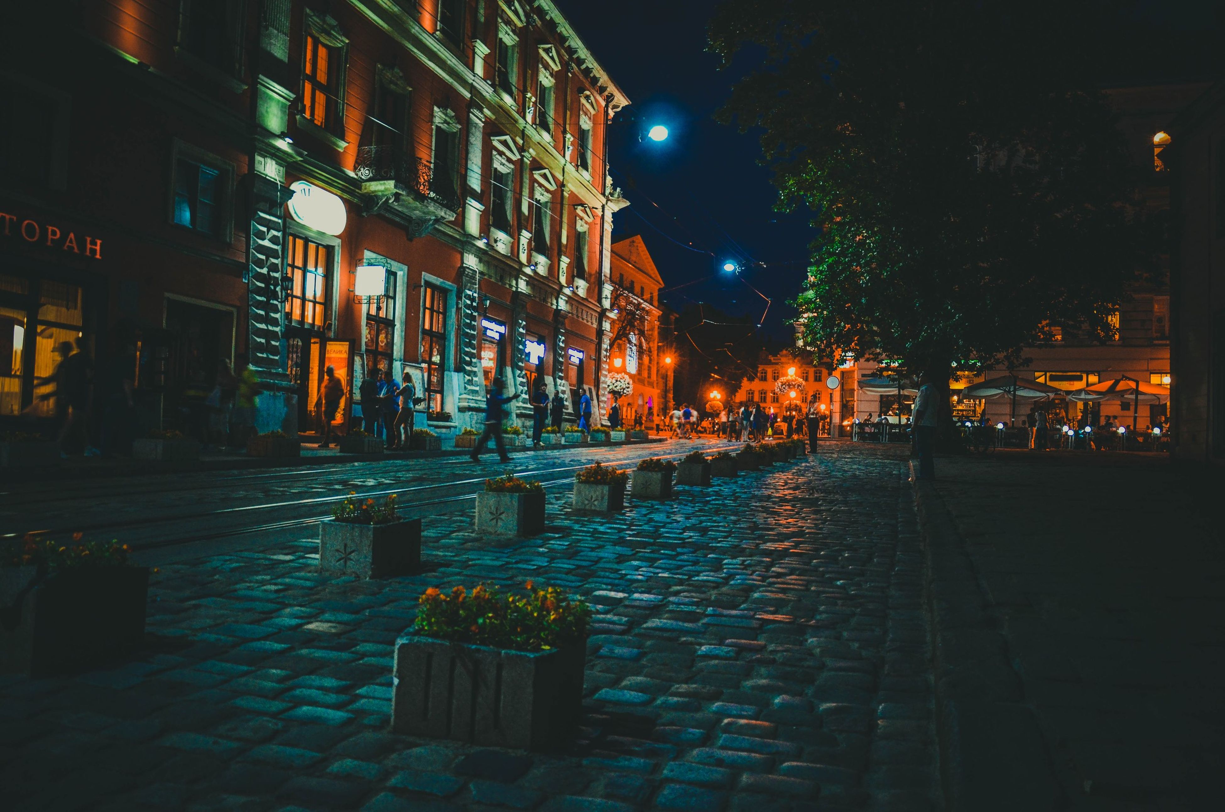 night, illuminated, building exterior, architecture, built structure, street light, lighting equipment, street, city, the way forward, building, residential building, light - natural phenomenon, cobblestone, residential structure, outdoors, road, sidewalk, city street, dark