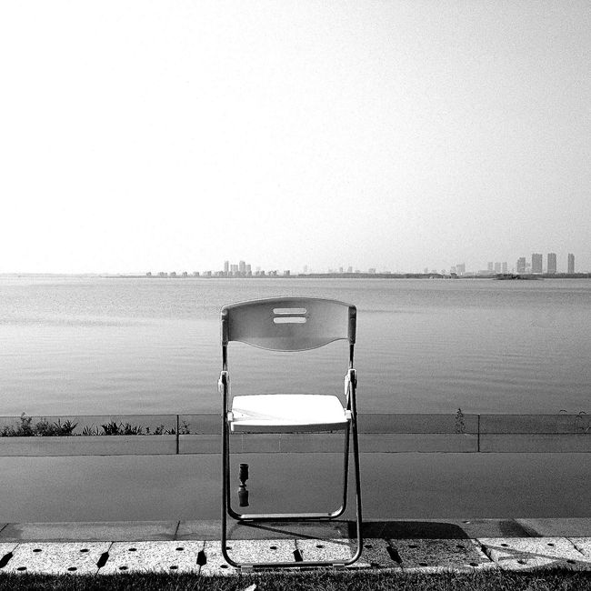 Beach Sand Sea Water No People Clear Sky Outdoors Nature Built Structure Day Chair Horizon Over Water Architecture Lifeguard Hut Black & White Black And White