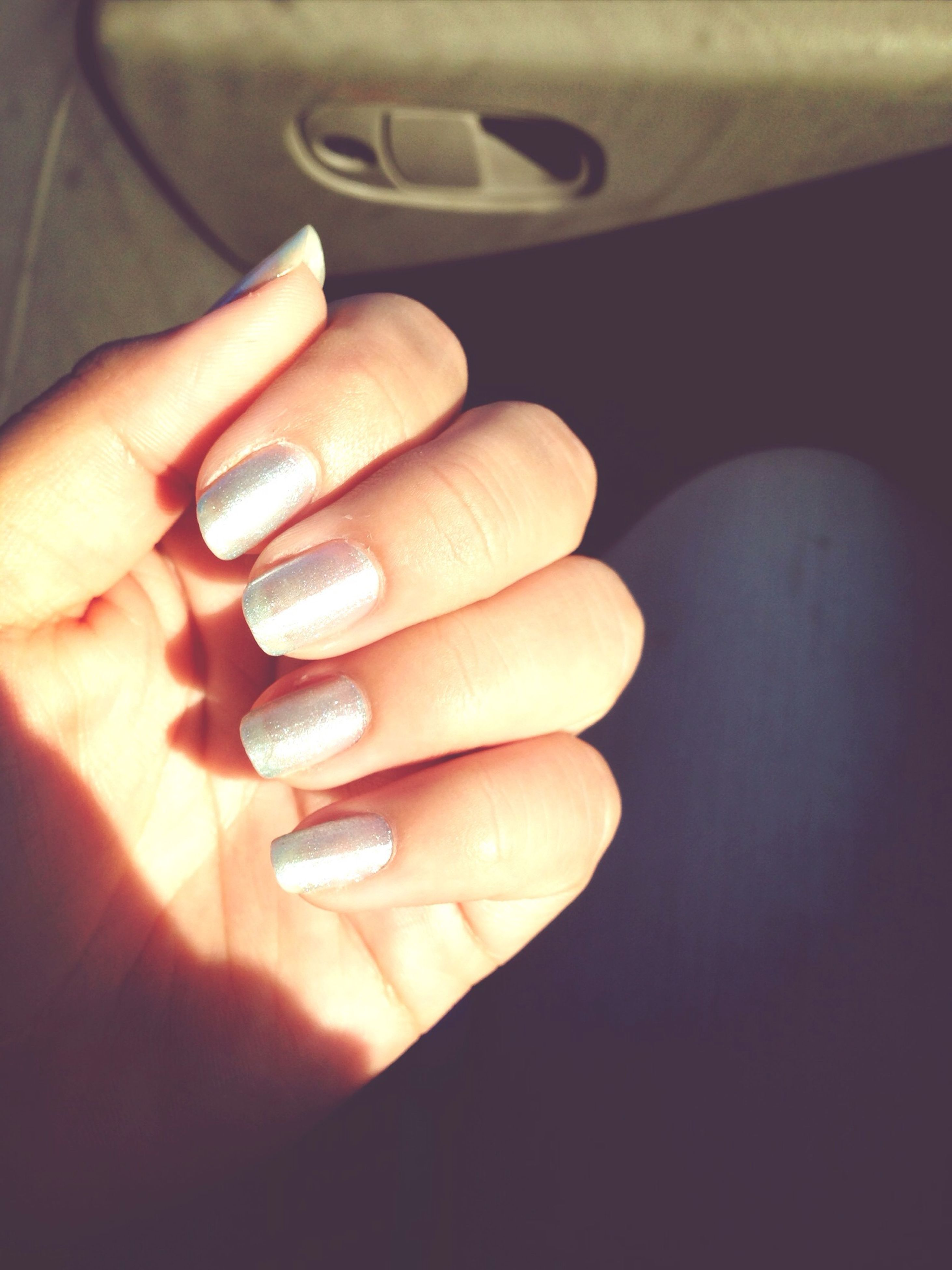 person, part of, indoors, human finger, holding, cropped, close-up, unrecognizable person, ring, personal perspective, showing, lifestyles, focus on foreground, nail polish, high angle view, table