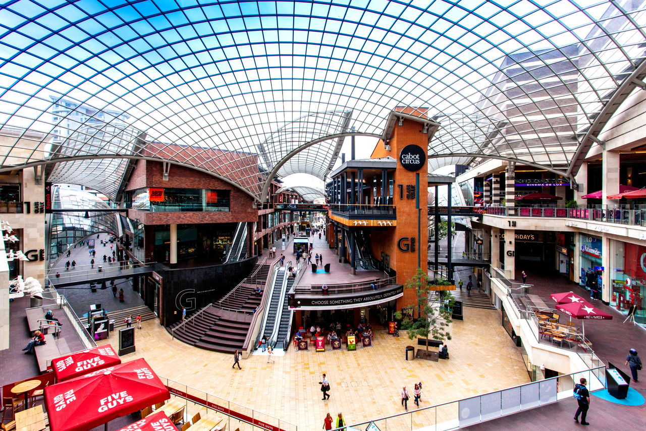 Interior of Cabot Circus shopping centre in Bristol Adult Architecture Bristol Built Structure Cabot Circus Carousel City Commerce Day Glass Roof Indoors  Large Group Of People Lifestyles Modern Panoramic People Real People Restaurants Retail  Shop Till You Drop Shopping Shopping Mall