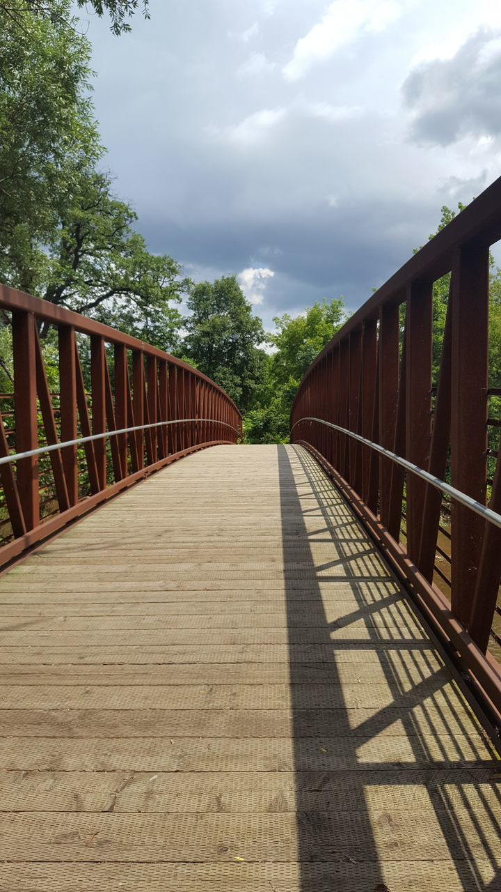 railing, the way forward, bridge - man made structure, cloud - sky, sky, tree, connection, day, transportation, outdoors, built structure, footbridge, no people, nature, architecture