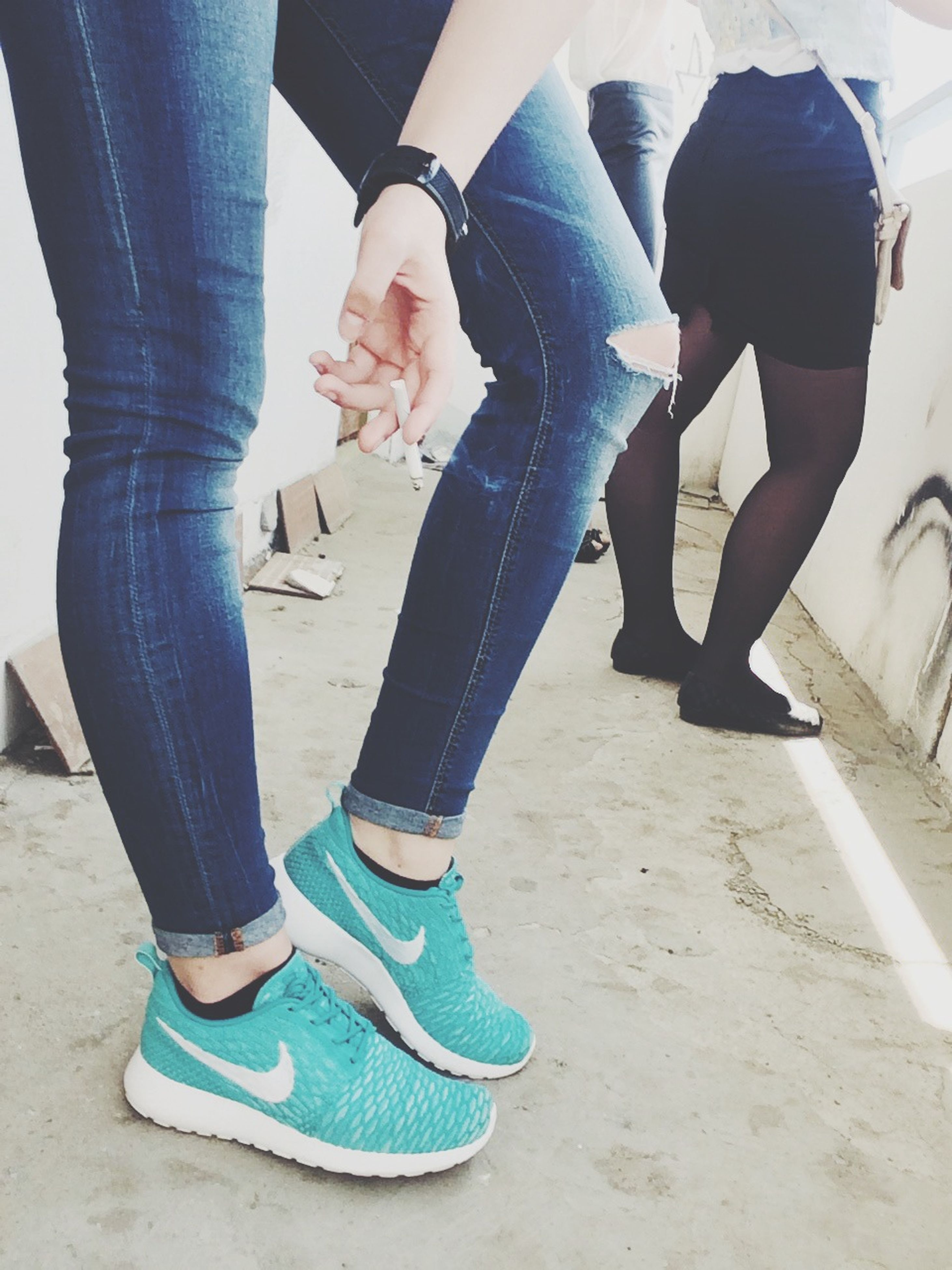low section, person, lifestyles, shoe, men, standing, leisure activity, casual clothing, human foot, jeans, togetherness, walking, sunlight, footwear, sitting