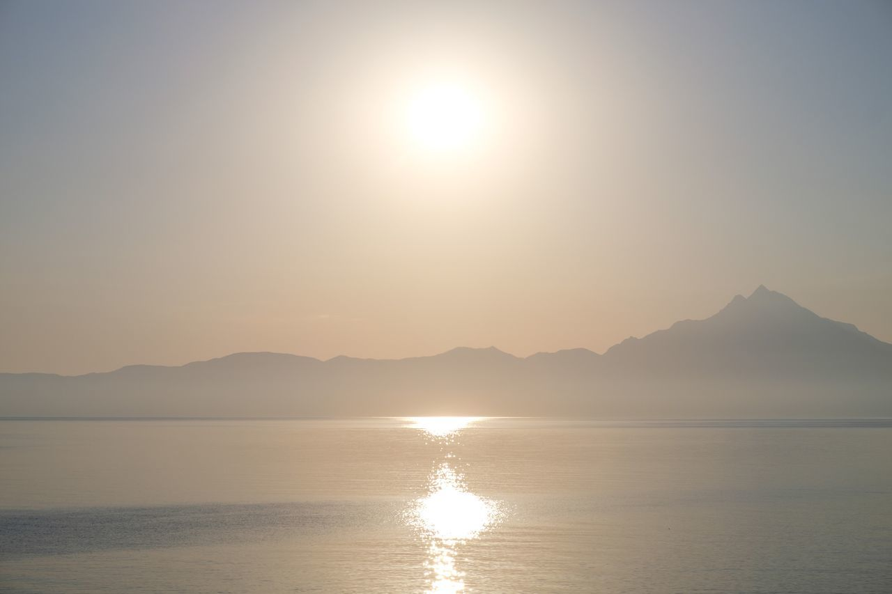 Sun Scenics Mountain Tranquility Tranquil Scene Sunset Reflection Sunlight Water Beauty In Nature Nature Sea Lens Flare Waterfront Outdoors Mountain Range Sky No People Landscape Clear Sky Greece Sarti Athos
