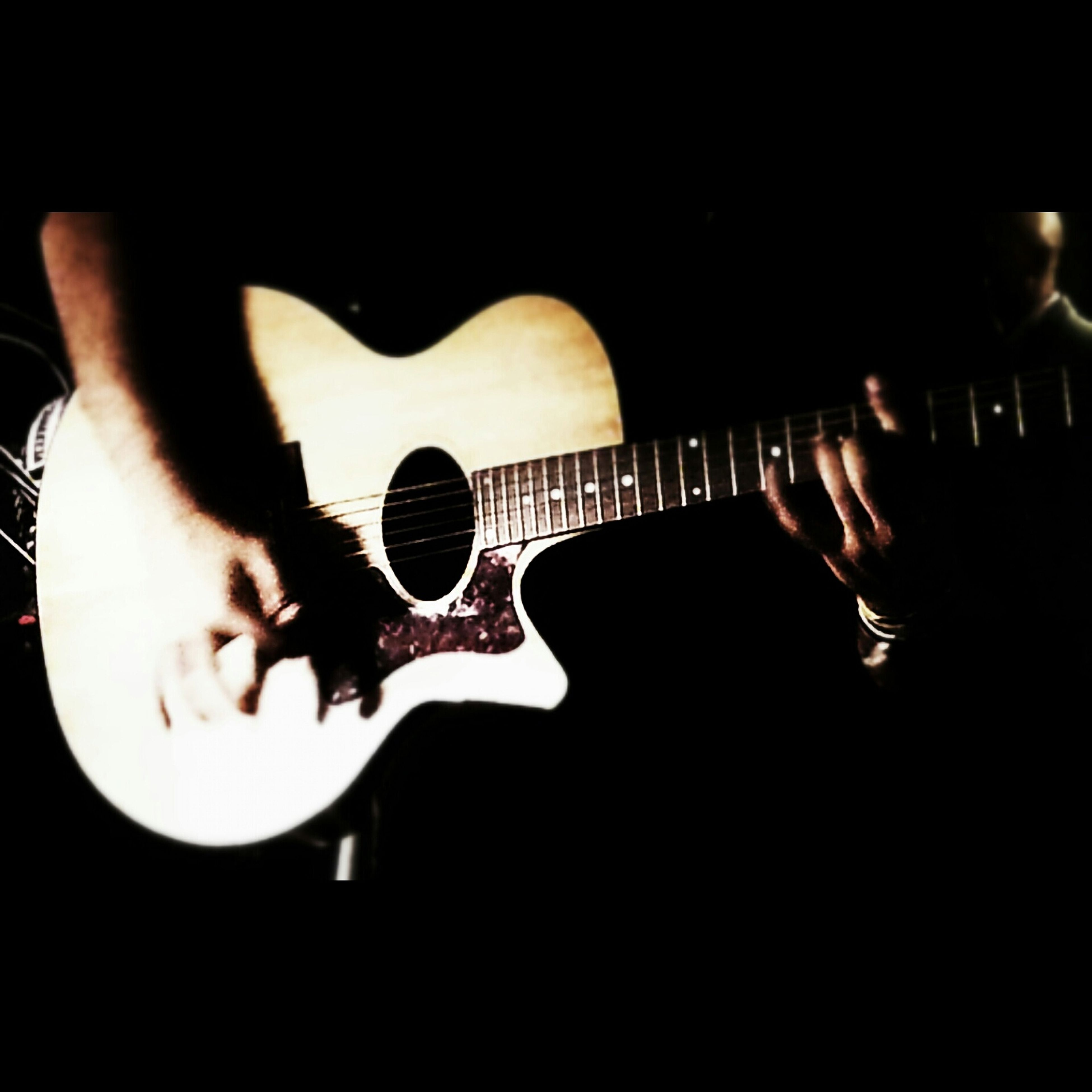 indoors, lifestyles, music, illuminated, leisure activity, arts culture and entertainment, holding, men, musical instrument, person, technology, night, photographing, photography themes, guitar, musician, dark, skill