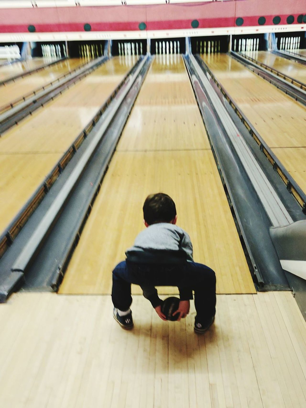 First time bowler. One Person Child Athlete Rear View People Full Length Bowling Alley Bowling Candlepin Bowling Boy Indoors  Day