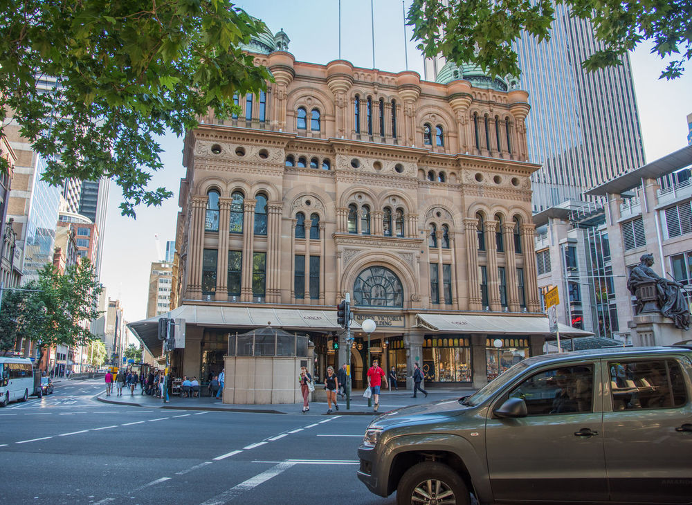 Sydney,NSW,Australia-November 18,2016: Queen Victoria Building Romanesque revival architecture and people in downtown Sydney, Australia Arch Architecture Australia Building Candid CBD City Street Crossing Cupola Dome Downtown Historic Lifestyles Queen Victoria Building QVB Real People Romanesque Street Light Sydney Tourism Tourist Tourist Attraction  Town Hall Travel Destination Urban