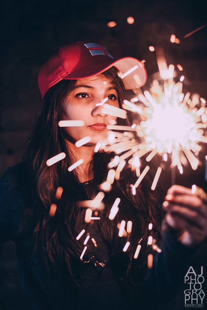 real people, one person, firework display, sparkler, flower, young women, firework - man made object, young adult, night, beautiful woman, standing, women, lifestyles, illuminated, outdoors, close-up, people
