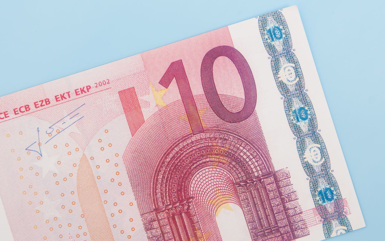 Various euro notes on light blue background Accounting Banking Credit Currency Debit Debt Euro Crisis Euro Notes Euro Zone Financial Financial Planning Financial Service Income Money Money Money Money Mortgage Pocket Money Spending Money Ten Euro