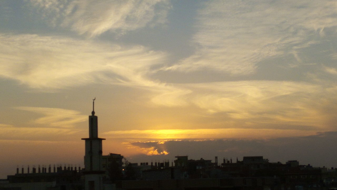 sunset, built structure, architecture, sky, building exterior, cloud - sky, city, travel destinations, silhouette, no people, skyscraper, outdoors, cityscape, nature, day