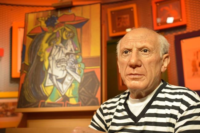 Pablo Picasso Art Art And Craft Close-up Confidence  Creativity Fashion Front View Happiness Holding Human Representation Indoors  Innocence Lifestyles Looking Away Madame Tussauds Person Portrait Real People Sitting Wax Dolls Wax Museum