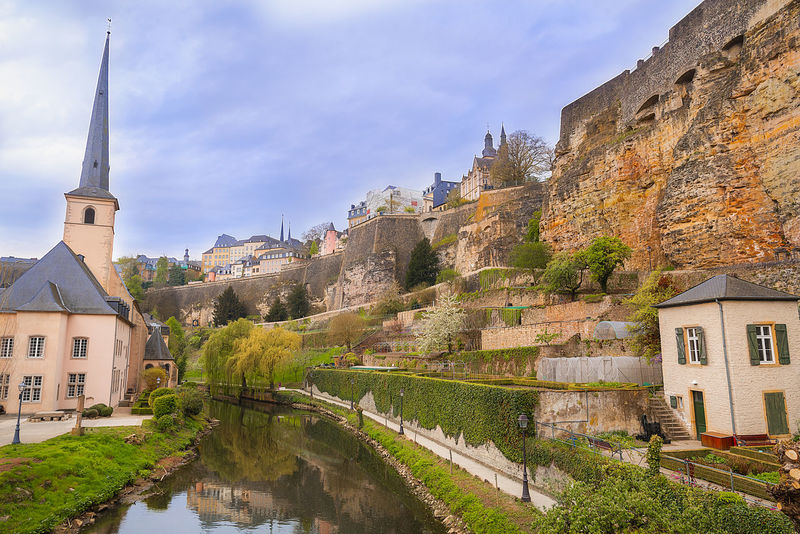 Medieval ruins on a river valley in Luxembourg - Ruins of the fortifications from the Former Castle of the Counts of Luxembourg, reflected on the water of the Petrusse river. Ancient Antique Castle European  Fortifications Historical Building Wall Architecture Building Exterior Built Structure Castle Cultures History Medieval Nature No People Outdoors River Ruins Architecture Travel Destinations Water Watter Reflection