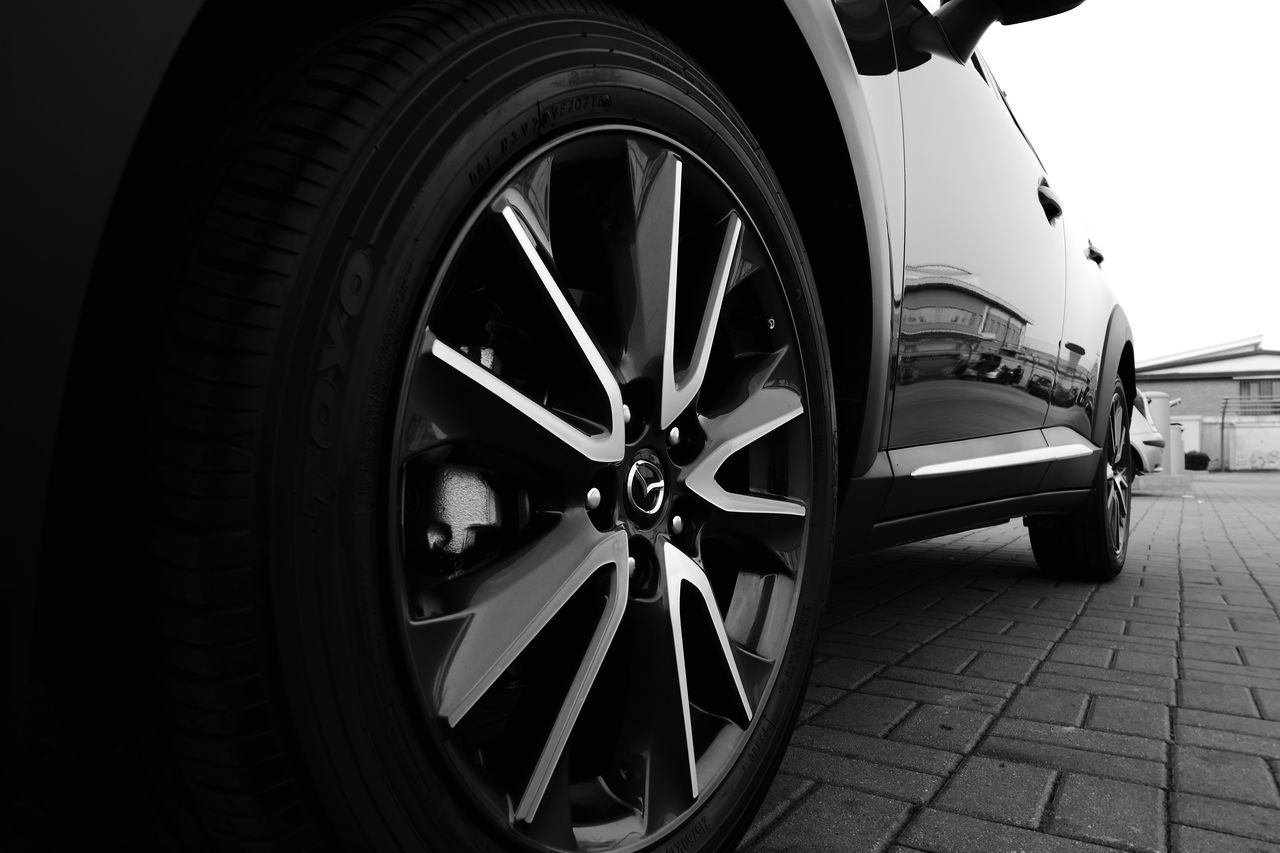 Mazda wheel Blackandwhite Car Close-up Day Land Vehicle Light And Shadow Mazda Mode Of Transport No People Outdoors Speed Tire Transportation Wheel