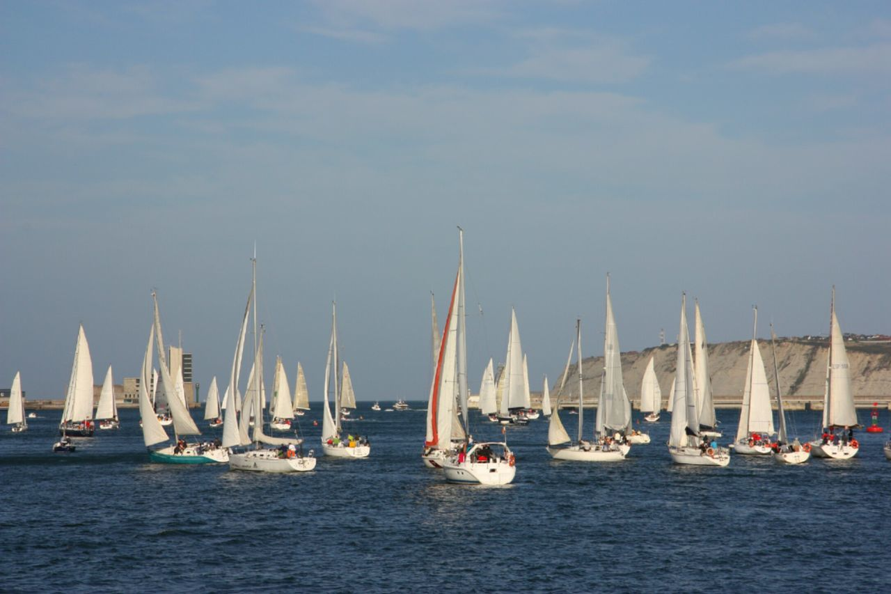 Nautical Vessel Sea Sailboat Water Sailing Beach Sport Outdoors Mast Sky No People Day Yacht Regatta Yachting