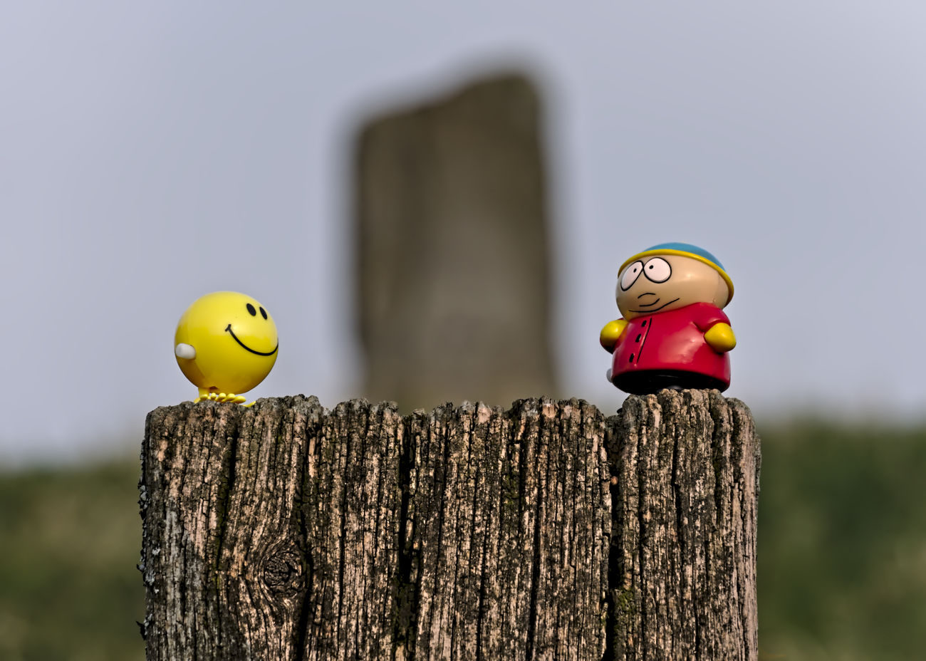 Tomb Adventure Barrow Best Friends Blue Sky Celtic Heritage Celtic Monument Close-up Day Eric Cartman Focus On Foreground Hochdorf Horizon Over Land Keltic Nikon Outdoors Selective Focus Smily Stone - Object Tombstone Toy Toy Adventures Toy Story Wood - Material Wooden Post Wooden Texture Yellow