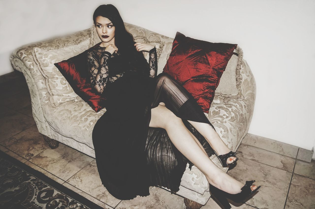 Beautiful stock photos of gothic, Attractive, Beautiful Woman, Black Hair, Couch