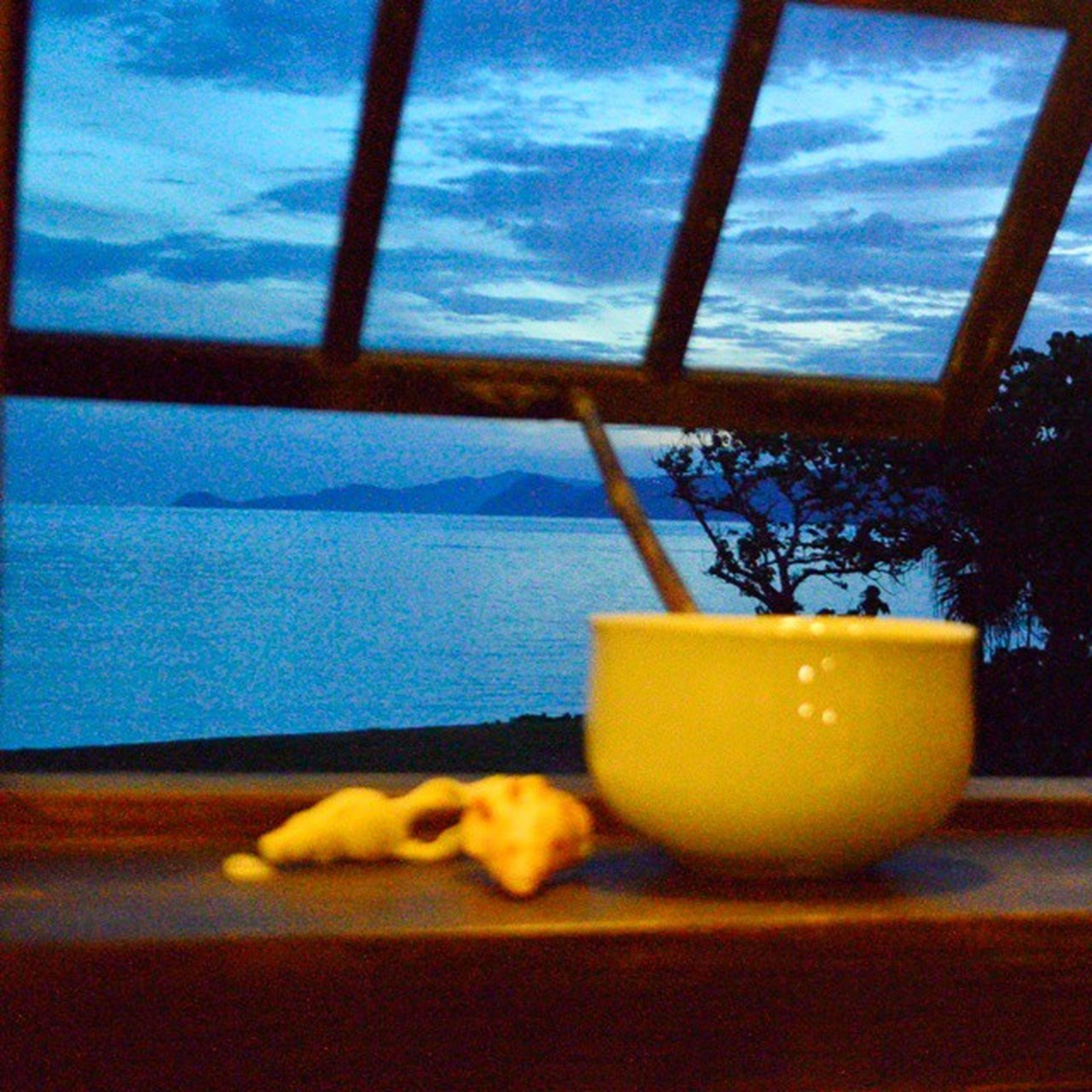 yellow, sky, sea, indoors, water, blue, horizon over water, window, table, close-up, sunset, sunlight, glass - material, transparent, no people, cloud, swimming pool, day, absence, part of