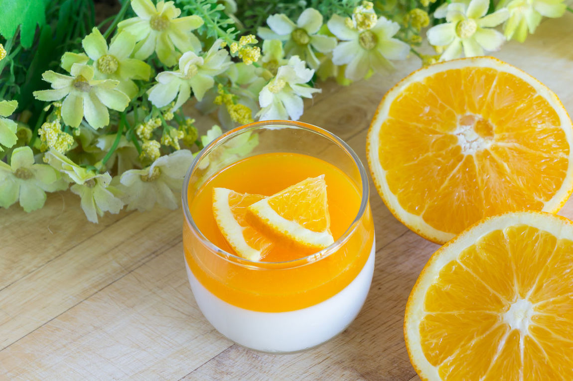 Orange Panna Cotta and Orange on Wooden background. Close-up Day Decoration Delicious Food Food And Drink Food And Drink Fresh Freshness Freshness Fruit Healthy Healthy Eating High Angle View Indoors  No People Nobody Orange Orange Panna Cotta Panna Cotta Sweet Table Tasty View Wooden