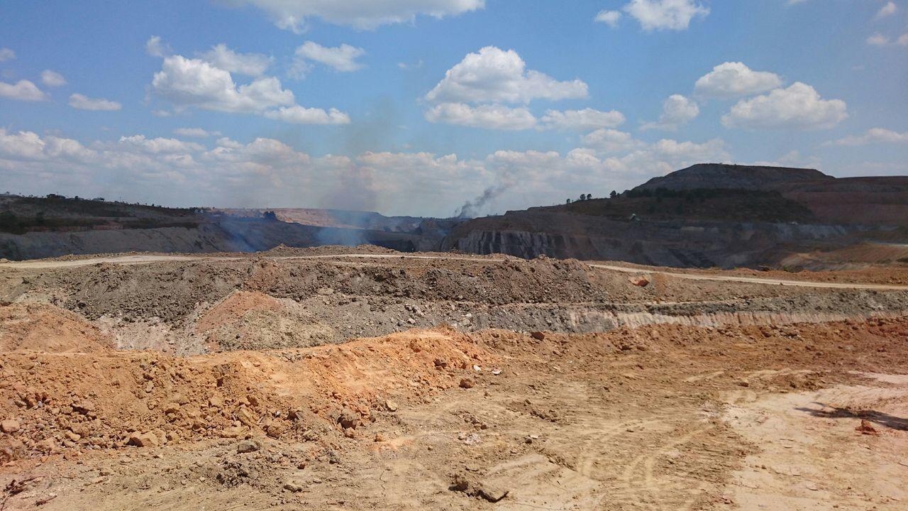 Smoke In Coal Mine Against Sky
