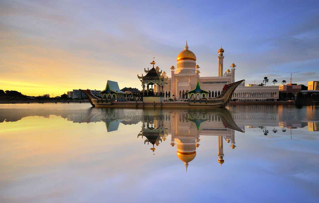 Sultan Omar Ali Saifuddin Mosque and reflection during sunset religion and beliefs religious place gold minaret Asian Culture Brunei Cityscape beautiful world religion architecture buildings & sky Modern Architecture Dawn light reflections in the water mosques of the world Waterscape mosquee BandarSeriBegawan boats landscape architecture photography miles away