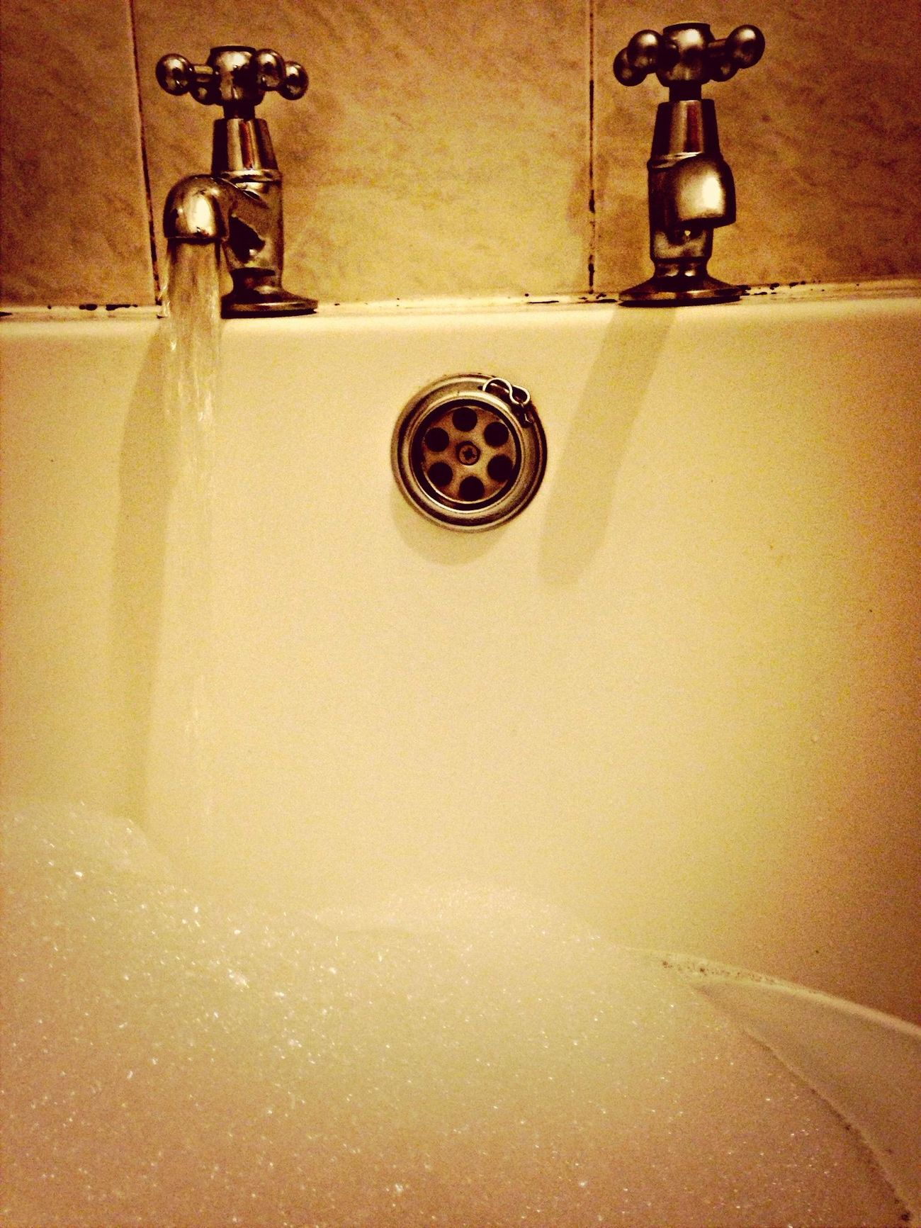 Hot bath with bubbles to relax in and forget how cold it really is.