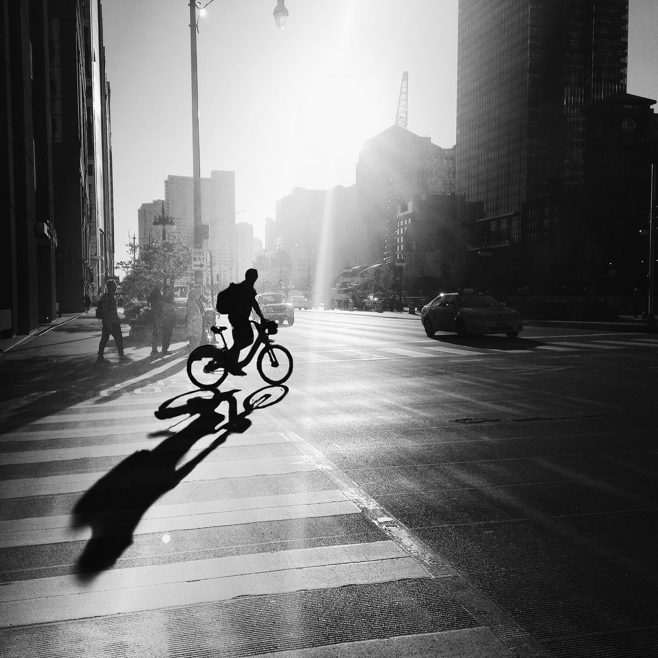 Land Vehicle City Transportation Bicycle Mode Of Transport Sunlight Built Structure Real People Building Exterior Street Full Length Architecture Men Outdoors Riding Cycling Silhouette One Person Day Only Men