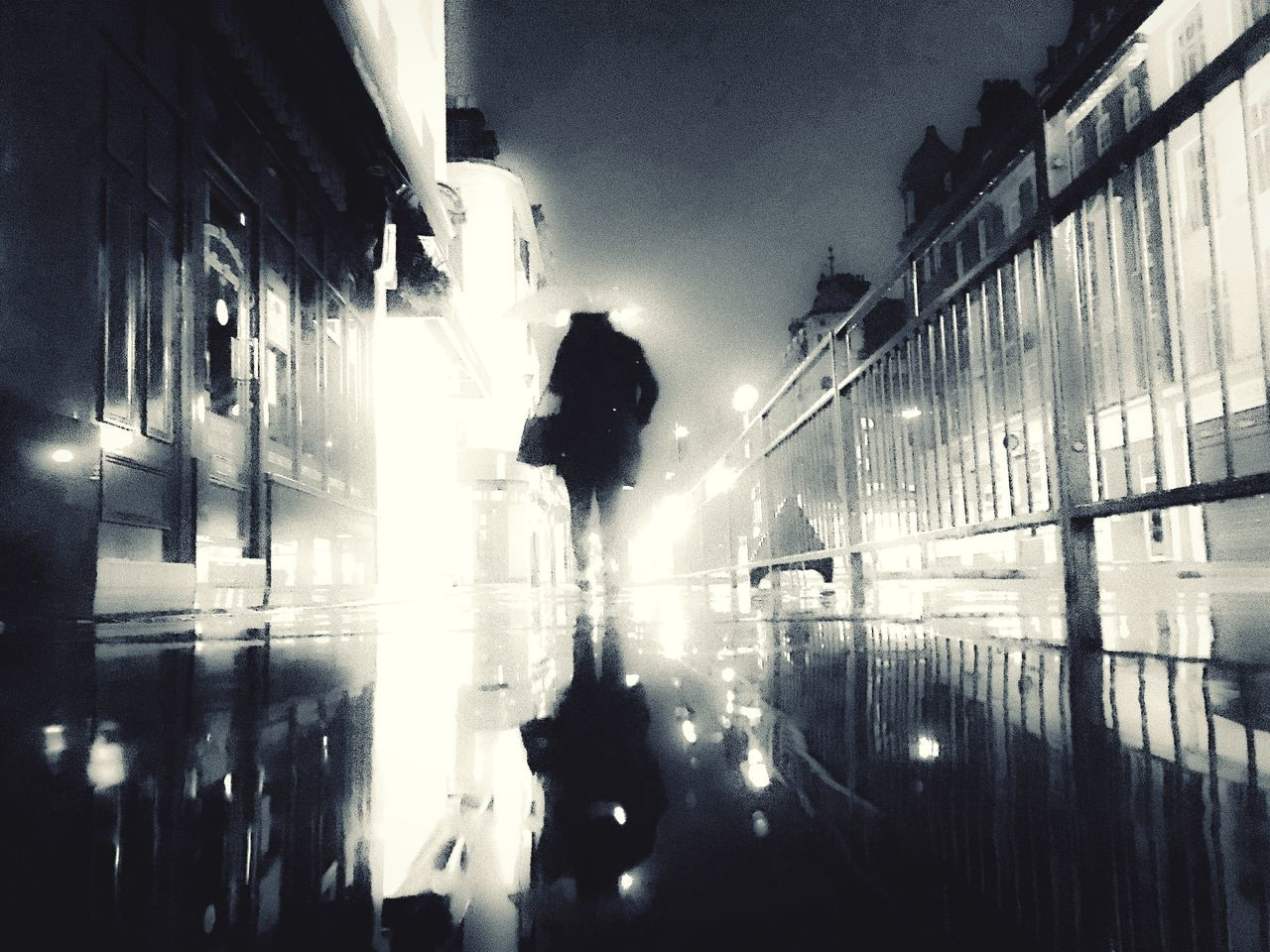 Urban Exploration Street Street Photography Reflection Wet Rear View Illuminated Low Angle View EyeEm Best Shots - The Streets EyeEm Best Shots Central London Fresh On Eyeem  The Week Of Eyeem Streetphotography Sidewalk Shop Windows Street Light Silhouette Vanishing Point Architecture Rain Umbrella One Person