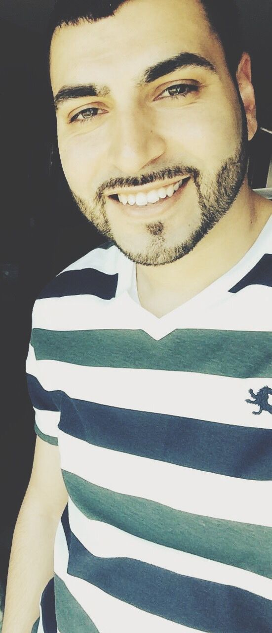 striped, young adult, portrait, smiling, looking at camera, young men, front view, one person, happiness, beard, real people, casual clothing, close-up, outdoors, day