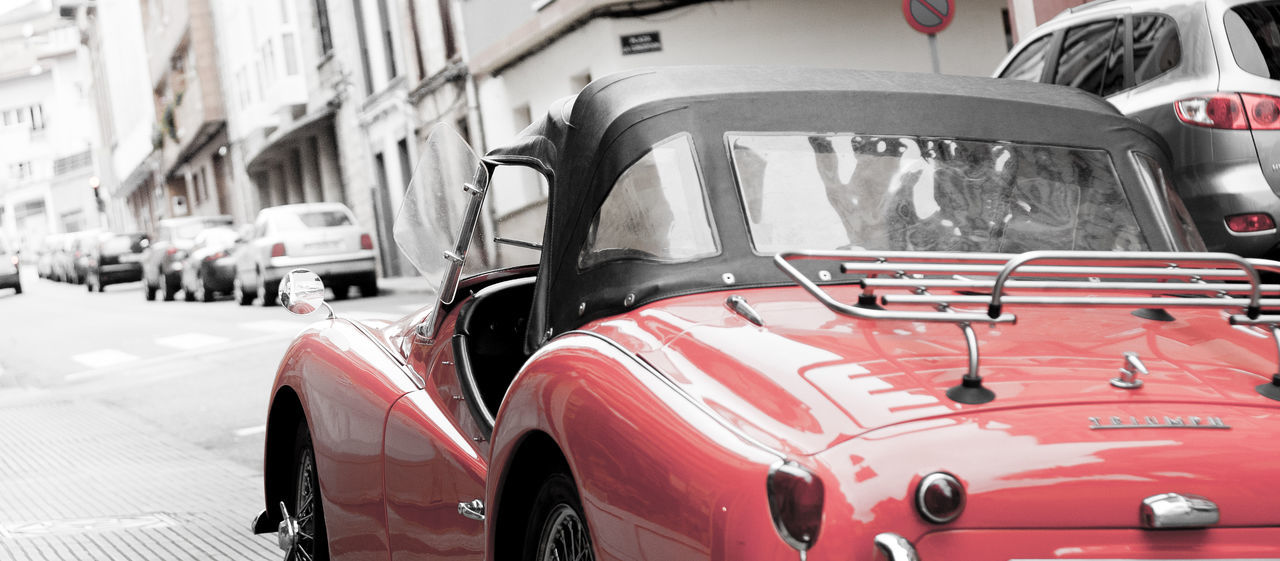 ''Like a black sheep in the flock'' Car City Colorpop Desaturated Effects Low Angle View Lust Luxury Panoramic Photography SPAIN Transportation