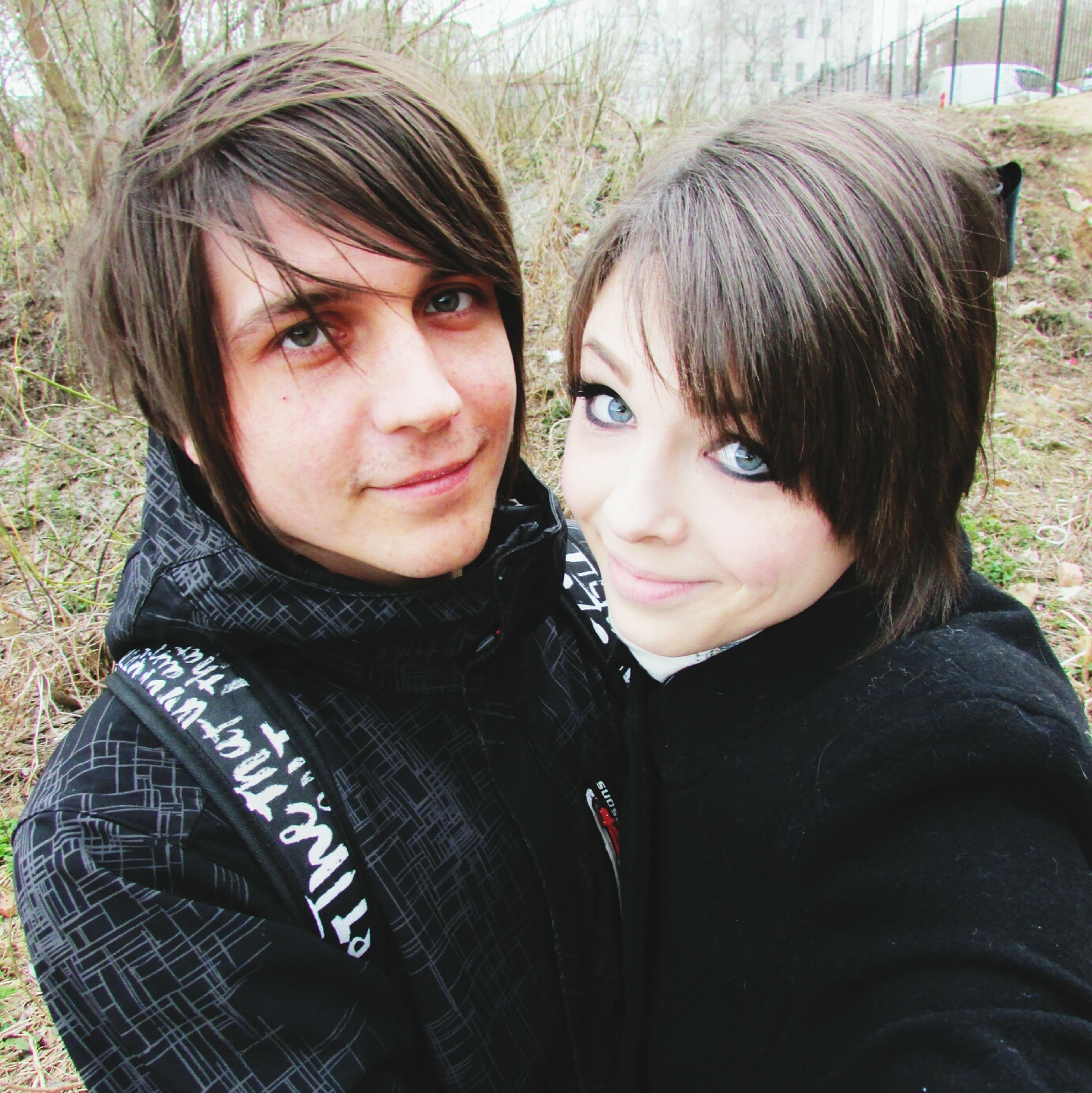 two people, looking at camera, real people, lifestyles, portrait, young women, young adult, leisure activity, togetherness, bonding, love, warm clothing, outdoors, day, close-up, beautiful woman, smiling, adults only, people, adult
