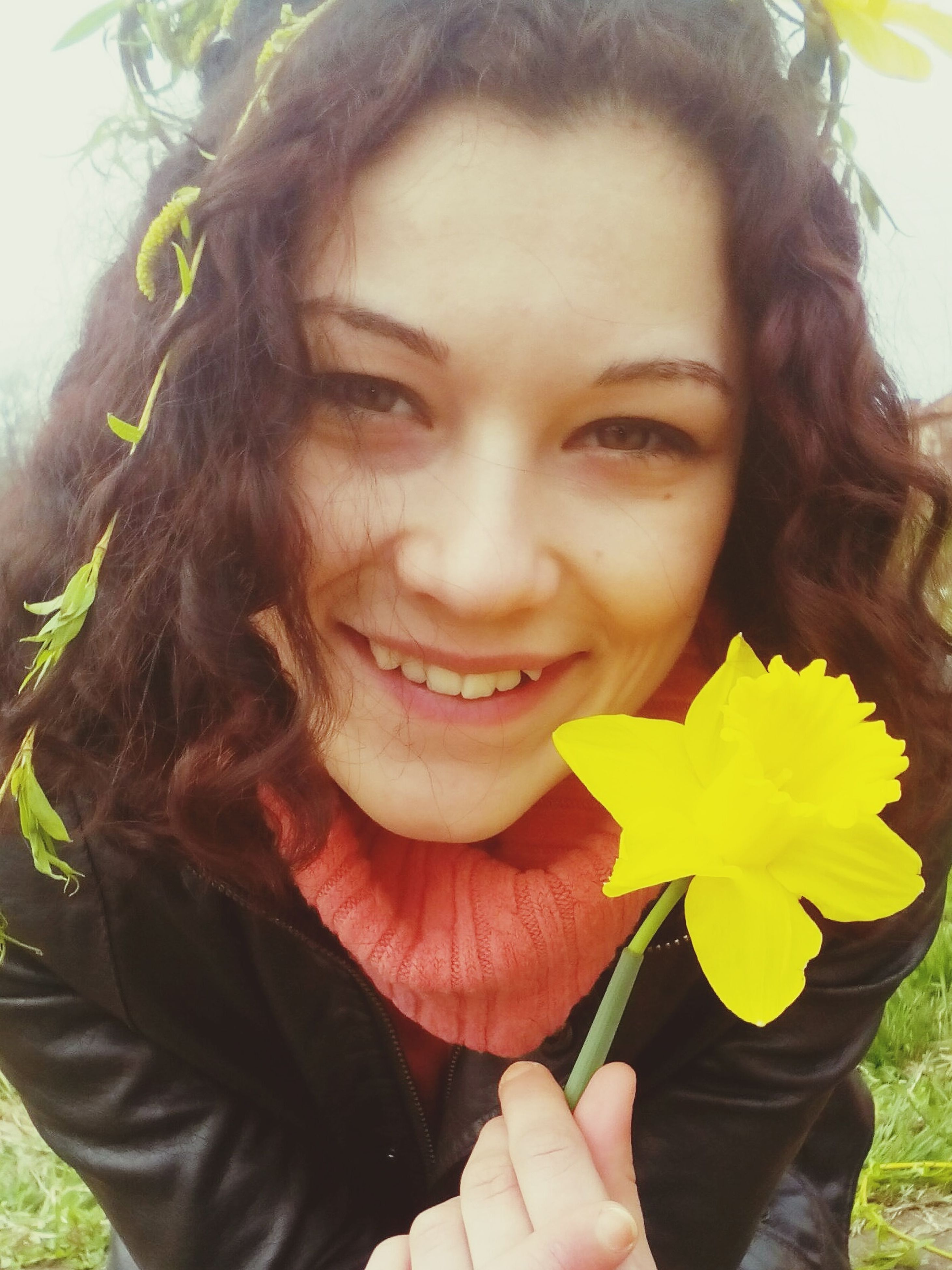 person, young adult, lifestyles, portrait, leisure activity, front view, looking at camera, young women, headshot, casual clothing, smiling, holding, flower, leaf, happiness, long hair, waist up, close-up