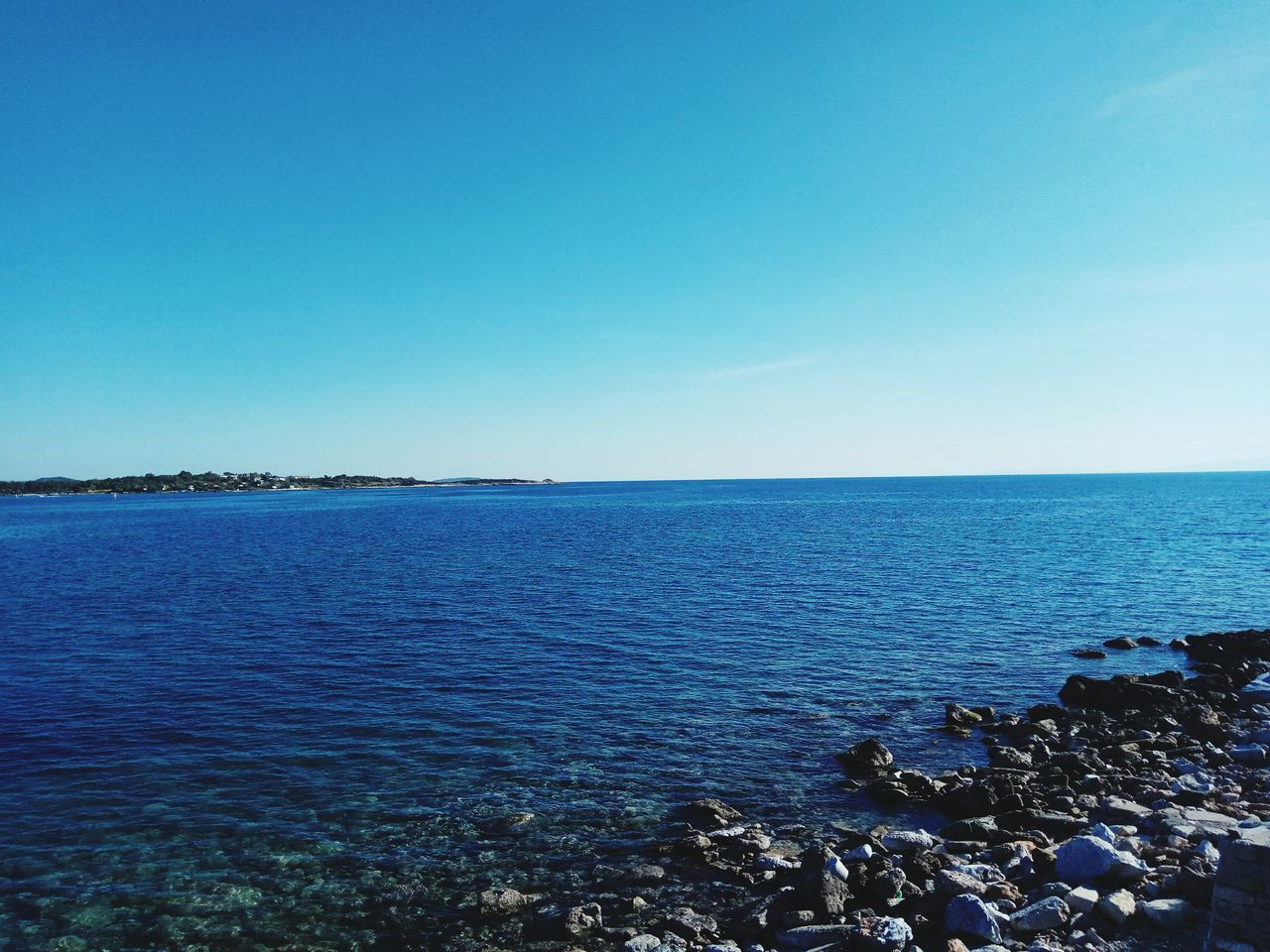 Sea Blue Beach Horizon Over Water Tranquility Water Scenics Nature Sky Clear Sky Travel Destinations Beauty In Nature Outdoors Day No People Beauty In Nature Greece Glyfada Greece Memories Reflection Vacation Destination Greece Photos Vacation Time