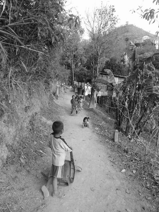 We Live In A Strange World..Where The Poor Walk Miles To Get Food.And the Rich walk miles To Digest Food...I Miss Being Little Kid, With No Stress,Worries Or Care In The World... Rich VS Poor Children Photography Black And White Photography Poor Kids Chidhood Memory Village Children Village Life My Commute-2016 EyeEm Photography Awards My Commute
