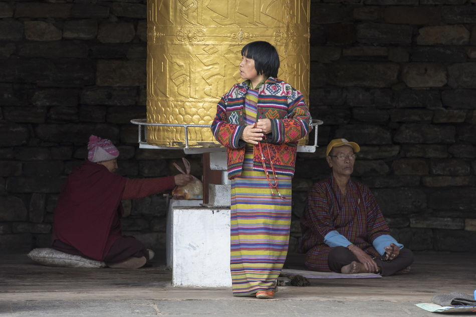 Prayer mill Bhutan Buddhist Buddhist Temple Cultures Prayer Mill Real People Traditional Clothing Traditional Costumes