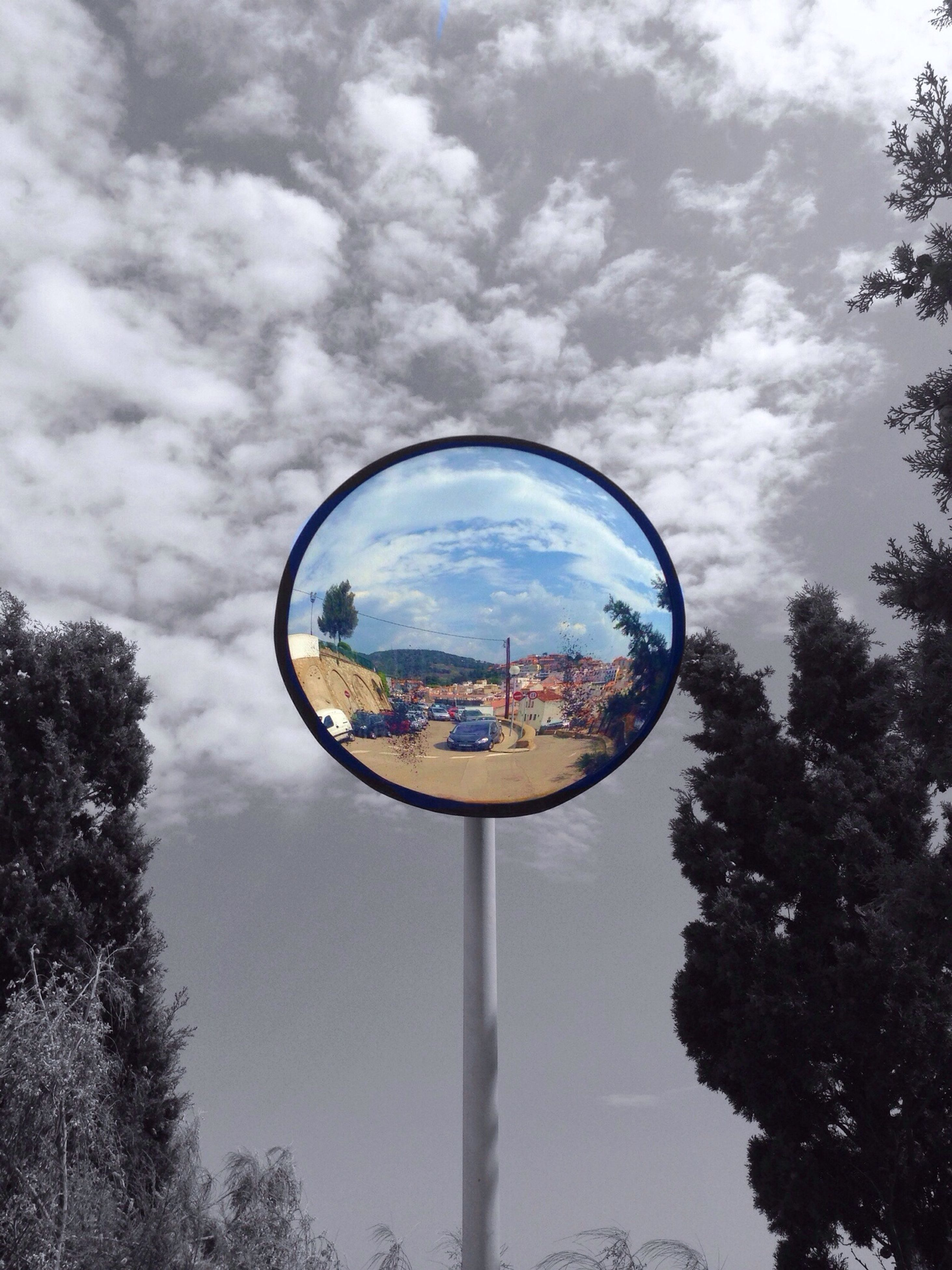 tree, sky, cloud - sky, reflection, cloud, transportation, low angle view, cloudy, circle, mode of transport, day, outdoors, nature, water, blue, no people, tranquility, silhouette, ferris wheel, tranquil scene