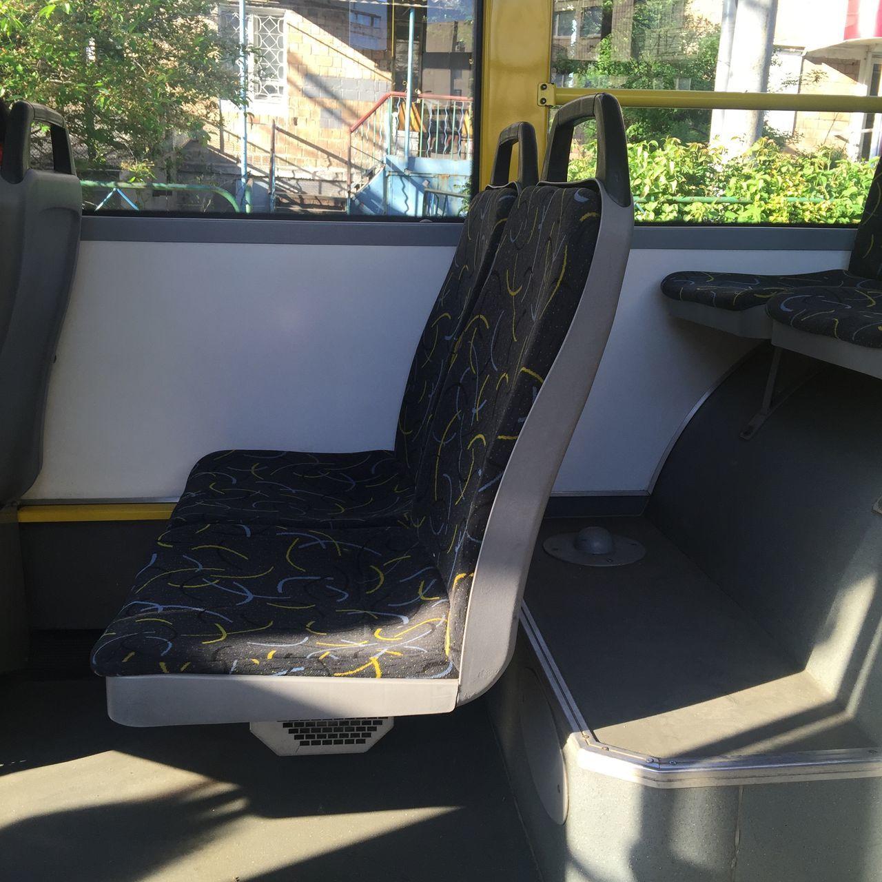 vehicle interior, no people, vehicle seat, transportation, mode of transport, land vehicle, day, car, window, indoors, close-up, seat, tree
