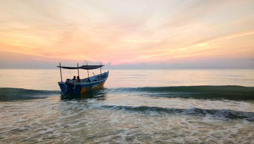 Beach Sea Outdoors Landscape Wave Sunrise Silhouette Boatman Boats And Sea Fisherman Sky Horizon Over Water